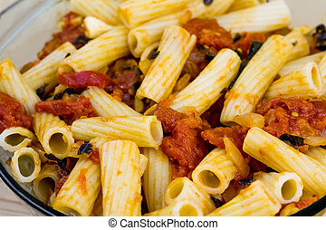 Cooked pasta with tomato sauce