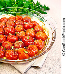 Tomatoes baked on granite table - Tomatoes small baked with...