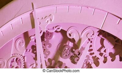 Decorative clockwork on banket - Changing light on the...