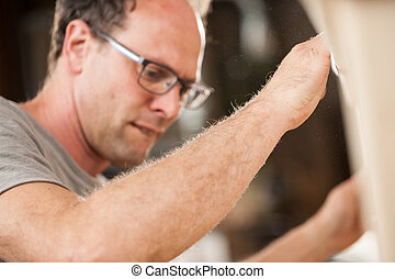 woodmaker working in his shop or lab - woodworker is a...