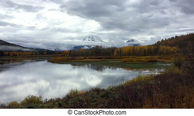 Thick Clouds over Grand Teton National Park Fall Colors -...