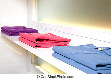 white store shelf with color clothes