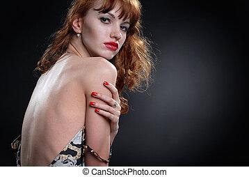 Attractive girl undress in studio