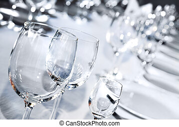 Glass goblets on white table