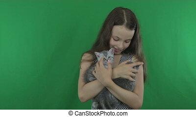 Beautiful girl communicates with kittens Scottish Fold on...
