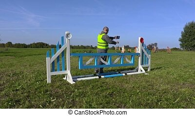 Horse handler take picture of hurdle