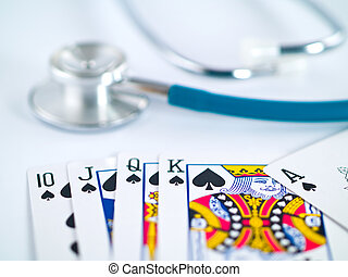 Stethoscope and Playing Cards as a Gambling with your Health...
