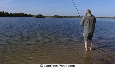 Angler tries to pull out fish