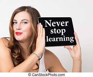 never stop learning written on virtual screen. technology,...