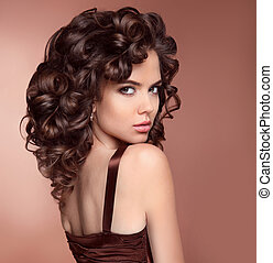 Attractive girl with curly hairstyle isolated on studio...