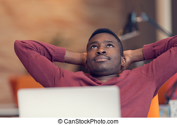 Young African-American business man taking a break at his desk