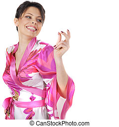 Smiling girl in kimono dancing isolated on white