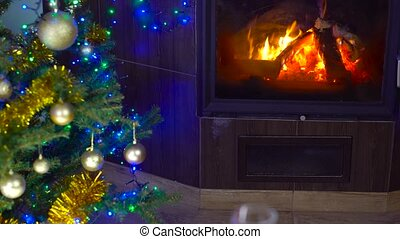 roasted chicken on christmas table in front of fireplace and tree with lights