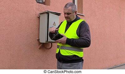 Electrician near fusebox