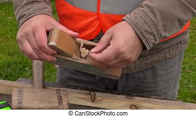 Carpenter from hand planer take chips out