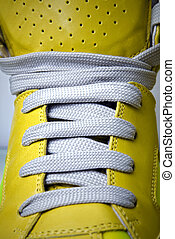 close-up laces on the yellow boots