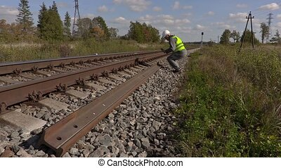 Railroad worker take pictures of the rails