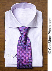 shirt with violet tie on wooden shelf