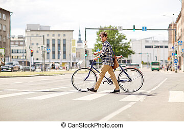 young man with fixed gear bicycle on crosswalk - people,...