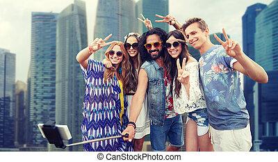 hippie friends with smartphone selfie stick - summer...