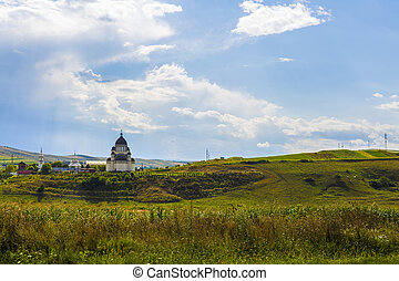 Christian church in a field in Romania