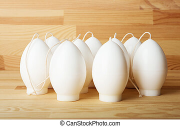 Decorative Handmade candles in the shape of eggs ready for painting and decorating for the holiday