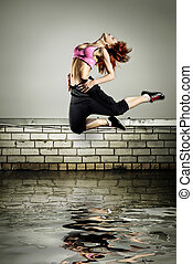 girl jumping on the roof in the water