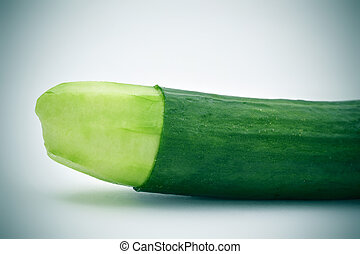 cucumber with the skin of its tip removed - closeup of a...