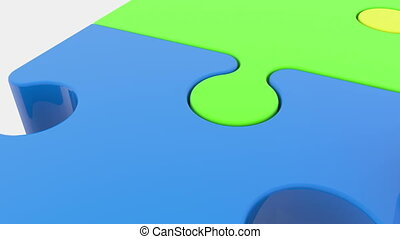 Moving puzzle pieces in four colors on white