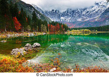 Lake Fusine ( Lago di Fusine) mountain lake in north Italy -...