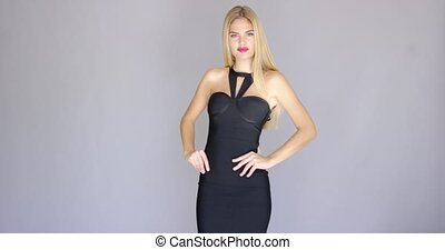 Curvaceous sexy young woman posing in elegant dress -...