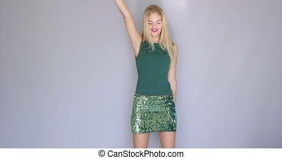 Happy and crazy beautiful young woman dancing while isolated...