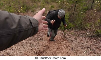Hiker get help to walking up to hill top