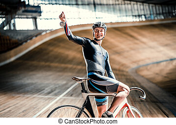 Sprinting - Young cyclist with a medal