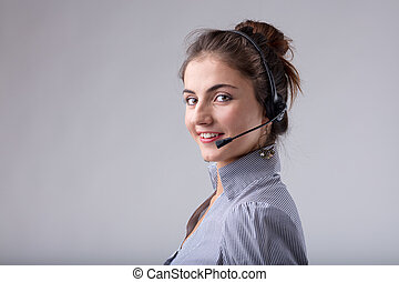 Attractive call center operator or businesswoman wearing a...