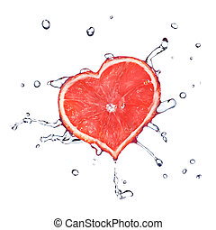 heart from grapefruit dropped into water with splash...