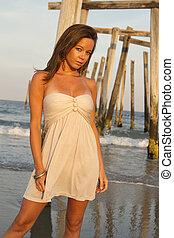 female modle portrait on beach fashon beauty