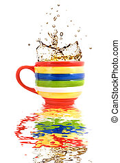splash of tea in color cup with reflection
