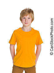 Cute young boy - A cute young boy stands on the white...