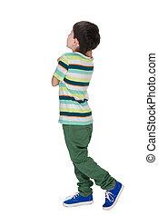 Little boy in a striped shirt looks back - A little boy in a...
