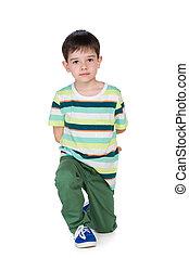 Cute young boy in ta striped shirt - A cute young boy in ta...