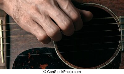 Guitarist hand and guitar strings. Music performance. 4K...