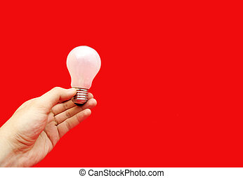 Background with lit lightbulb Isolated on red