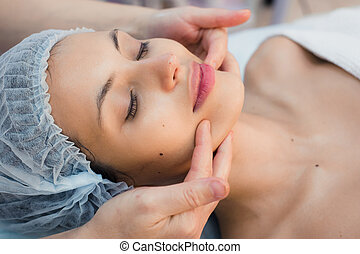 Young, beautiful and healthy woman in spa salon. Traditional oriental massage therapy, beauty treatments.