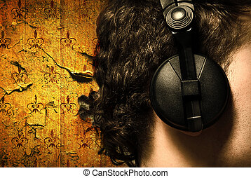 urban style photo of the man in headphones listening to musi?
