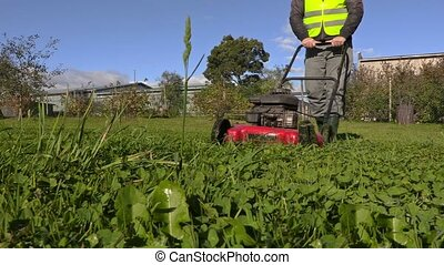 Man with lawnmower cloce up