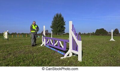 Man with barrier near hurdle