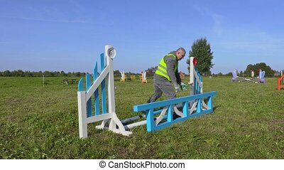 Man fix hurdle in required height