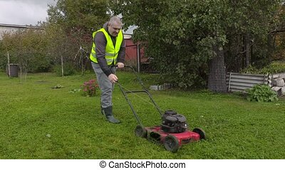 Man try started lawnmover