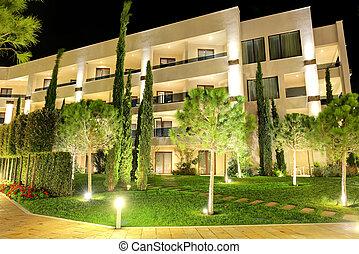 The trees in night illumination at luxury hotel, Halkidiki,...